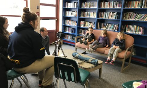 secondary students interviewing elementary students