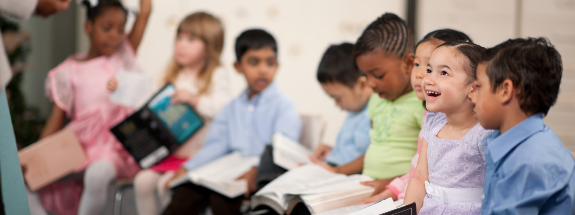 primary ages children read bible together