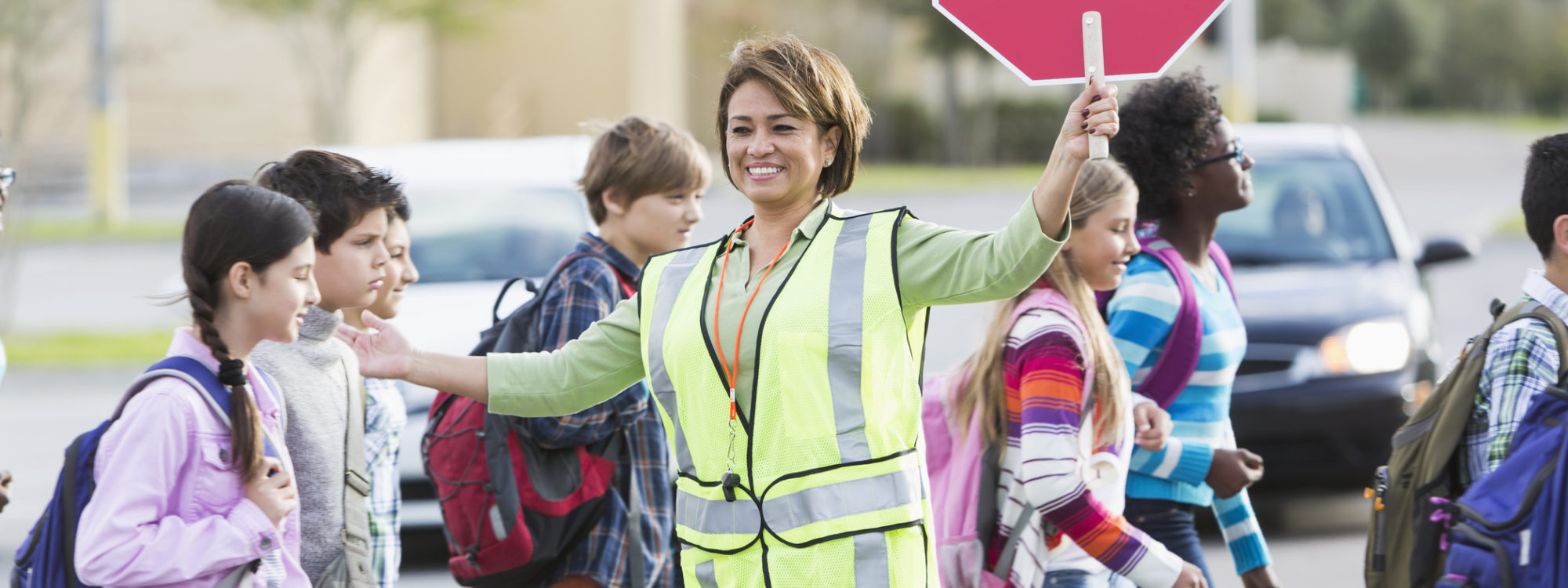crossing guard and students