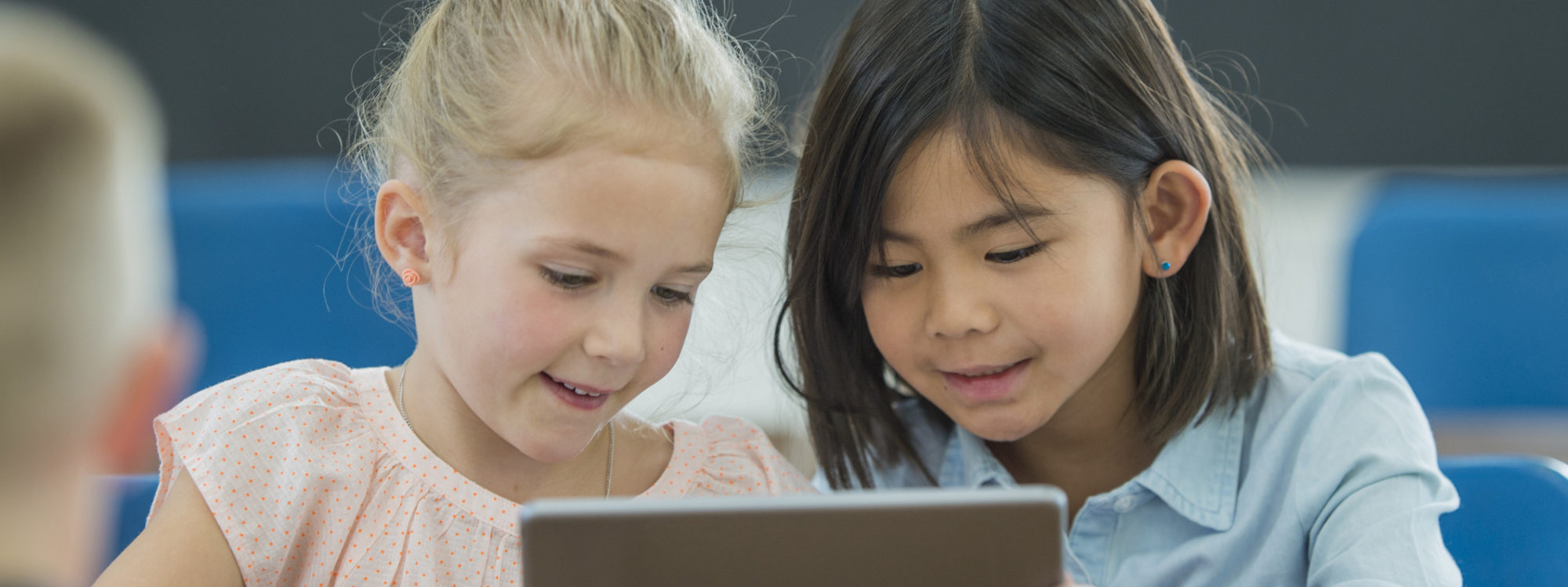 two students sharing tablet device