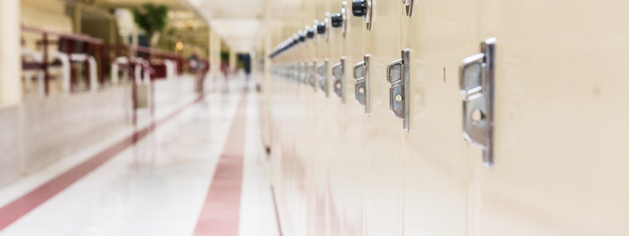 School hallway with rows of lockers