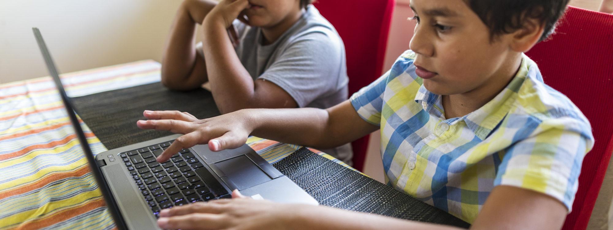 students sharing laptop