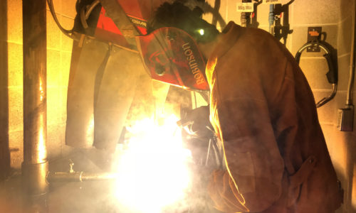 person perfomring welding
