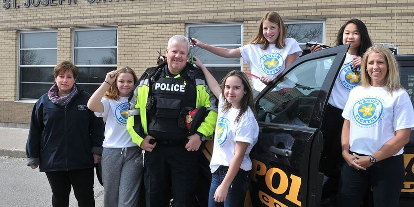 student posing with community officer