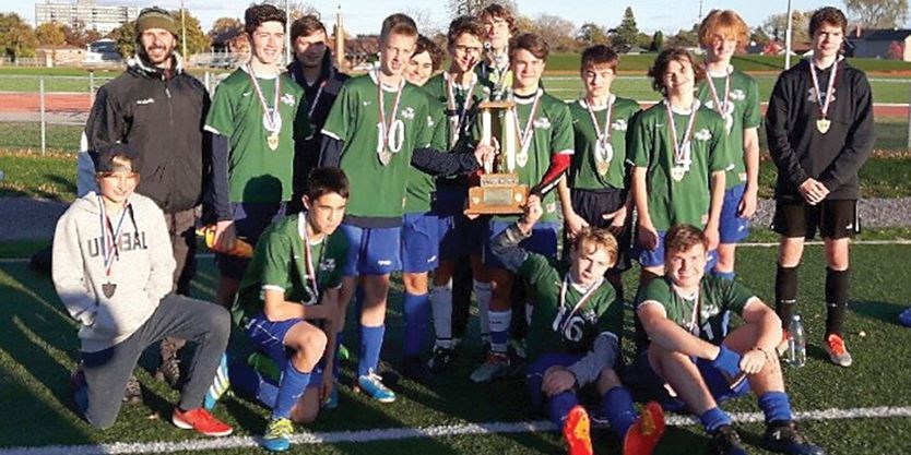 boys soccer team with medals
