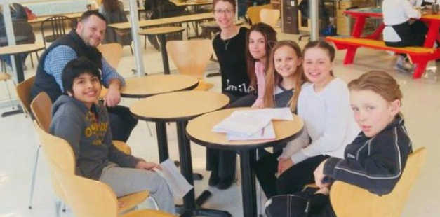 student sitting at tables