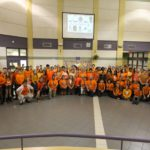 staff and student wearing oranges shirts