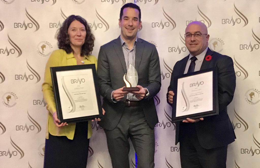 PVNC staff members holding awards