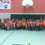 students and staff wearing orange shirts