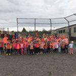 staff and student wearing orange shirts