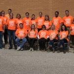 staff wearing orange shirts