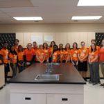 students wearing orange shirts