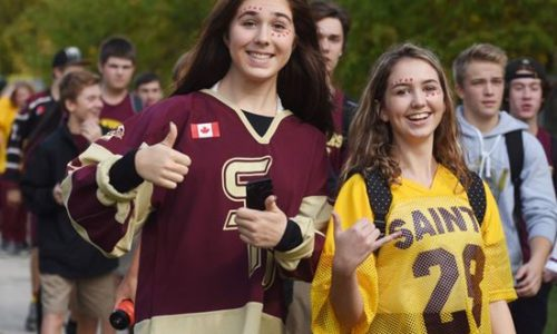 St. Peter and Holy Cross students participate in a Terry Fox Run event on Thursday (Oct. 11). Students from both schools met at Weller Street and Medical Drive and walked around the St. Peter community before gathering for a senior boys football game. - Lance Anderson/Metroland