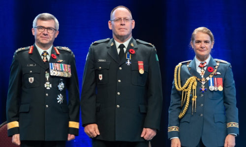 three people in military dress