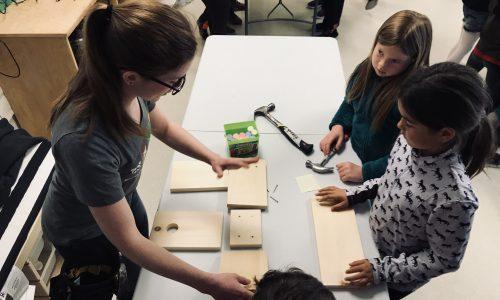 student building a bird house