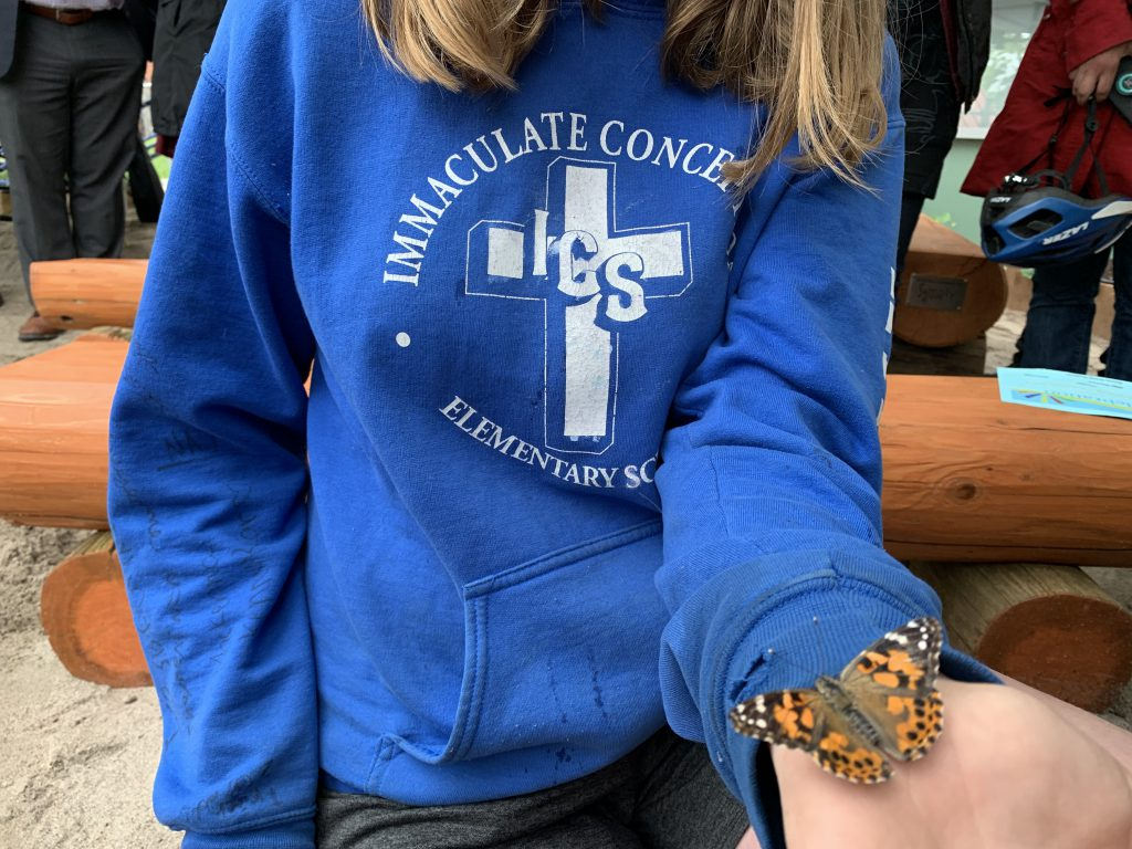 student holding butterfly