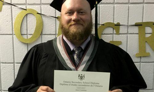 man holding diploma