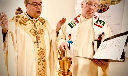 two priests performing mass