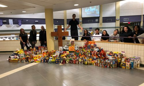 staff and students with food drive collection