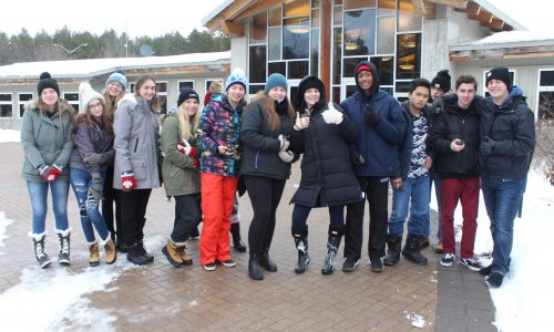 groups of students dressed in winter clothing