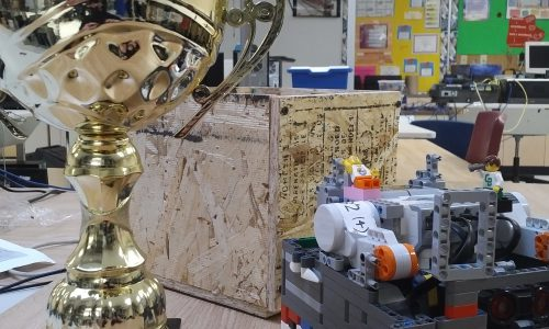 2nd place trophy next to lego robot