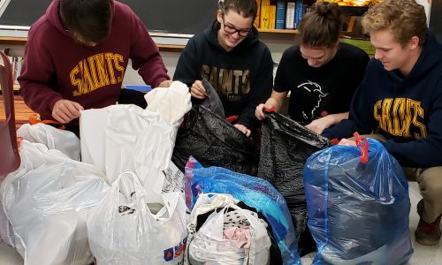 students with donations of clothing for Community Drive