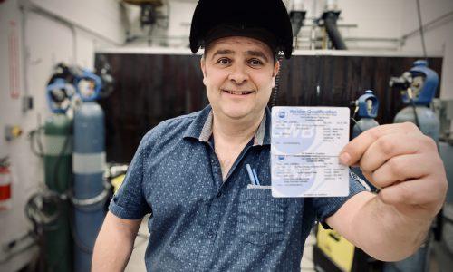 teacher showing welding certification