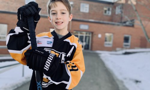 boy in hockey sweater