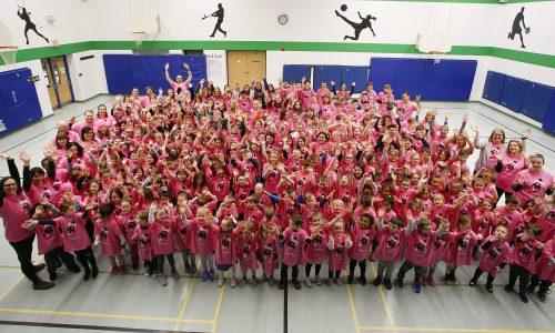 student wearing pink shirts