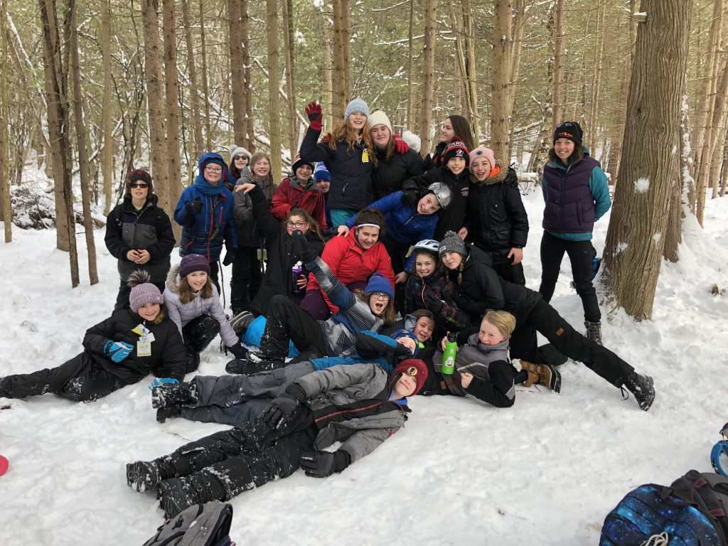 A picture of education award winner Anne Corkery with her classroom in the outdoors