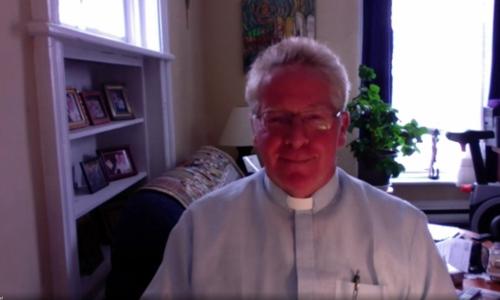 A Screen Grab of Board Chaplain Fr. Paul Massel