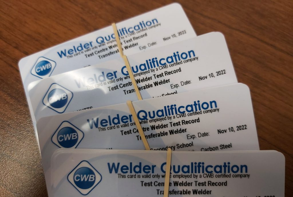 A bundle of welding certifications