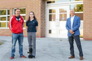 Photo of Ava Stewart, Ryan Stewart, and Trevor Poechman.