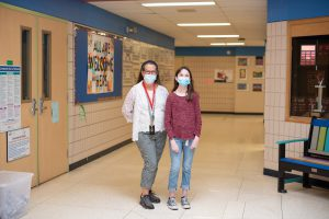 Photo of Shea with Education Assistant Kathryn Komar.